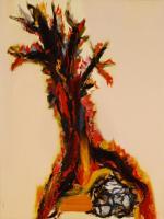 Árbol rodeando una piedra